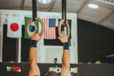 Free Gymnast Near Assorted Country Flags Stock Photo - 113295100