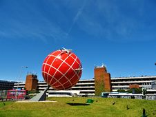 Free Red And White Globe Statue Near Brown And White Concrete Building Stock Image - 113295181
