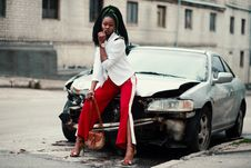 Free Woman With White Long-sleeved Shirt, Red ,and White Slit Pants And Pair Of Black Open-toe D Orsay Heel Sandals Sitting On Wre Stock Photography - 113295232