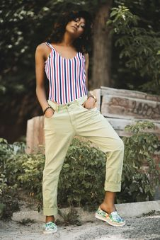Free Woman In White And Black Stripe Spaghetti Strap Top And Beige Pants Stock Photography - 113349662