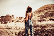 Free Woman Wearing Blue-washed Overalls Near Rock Formation Stock Photo - 113349710
