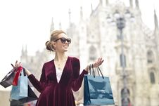 Free Woman Wearing Maroon Velvet Plunge-neck Long-sleeved Dress While Carrying Several Paper Bags Photography Stock Photo - 113349720