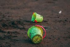 Free Two Green Pails On Ground Stock Photo - 113416770