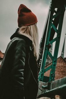 Free Woman In Black Leather Zip-up Jacket Near Green Metal Stand Royalty Free Stock Images - 113416829