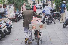 Free Man Walking With Bike Stock Images - 113416964