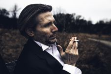 Free Photo Of Man Holding A Cigarette Stock Photo - 113416980