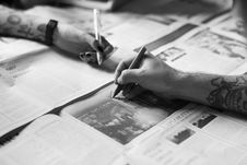 Free Grayscale Photo Of Hands Writing On The Newspaper Royalty Free Stock Photography - 113417057