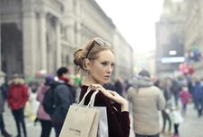 Free Woman Wearing Maroon Long-sleeved Top Carrying Brown And White Paper Bags In Selective Focus Photography Stock Image - 113417071