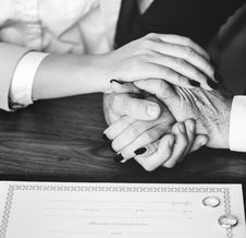 Free Person Holding Their Hands On Brown Wooden Table Royalty Free Stock Photos - 113472678