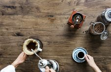 Free Person Making Coffee Beside Person Holding Cup Of Coffee Stock Photography - 113472812