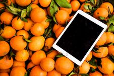 Free Photo Of Ipad On Orange Fruits Royalty Free Stock Image - 113472956