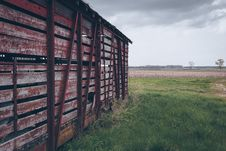 Free Photo Of Red Wooden Shed On Green Grass Field Royalty Free Stock Image - 113472986