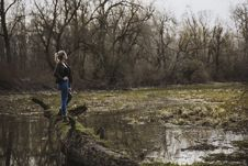 Free Woman Wearing Black Cardigan And Blue Pants Looking On Brown Forest Stock Photography - 113473012