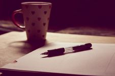 Free Black Pen On White Printed Paper Near White Ceramic Mug Stock Photography - 113473022