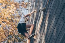 Free Man Wall Climbing Beside Trees Stock Image - 113473091