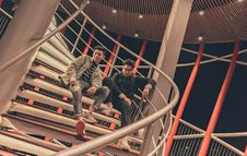 Free Two Men Sitting On Spiral Stairway Stock Images - 113473104