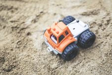 Free Orange And Gray Plastic Truck Toy On Sand Royalty Free Stock Photos - 113641868