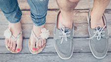 Free Closeup Photo Of Person Wearing Gray Boat Shoes And Gray Flip-flops Royalty Free Stock Image - 113641906
