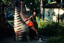 Free Photo Of Woman Beside Zebra Statue Stock Photography - 113642102