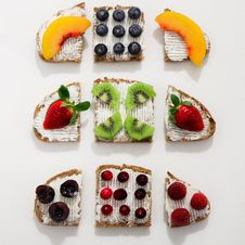 Free Baked Breads With Fruit Toppings Royalty Free Stock Photos - 113809068