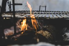 Free Burning Under Black Metal Grill Stock Images - 113809124