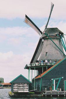 Free People Walking On Windmill Near Body Of Water Stock Image - 113907651