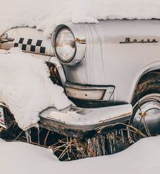 Free Close-Up Photography Of Vintage Car Covered With Snow Stock Image - 113907801