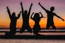 Free Silhouette Of People Jumping Stock Photo - 113947560
