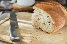 Free Sliced Bread And Stainless Steel Knife On Top Of Brown Wooden Chopping Board Stock Photography - 113947592