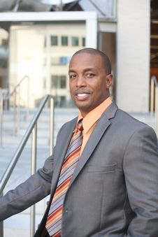 Free Man Wearing Gray Blazer And Orange Dress Shirt Stock Images - 113947594