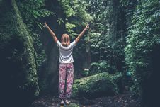 Free Woman With Raising Arms Facing Pathway Between Forest Trees Stock Image - 113947681