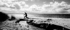 Free Grayscale Photography Of A Person Jumping Over Body Of Water Stock Photography - 113958182