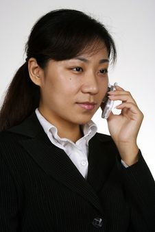 Asian Girl On The Phone Royalty Free Stock Photo