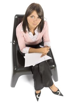Free Woman On The Chair Doing Notice Royalty Free Stock Photos - 1148268
