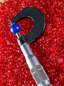 Micrometer With Beads And Balls Stock Image