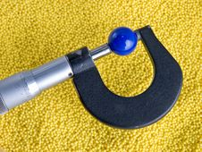 Micrometer With Beads And Balls Stock Images