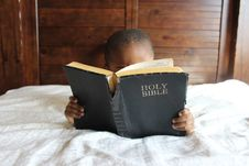 Free Photo Of Child Reading Holy Bible Royalty Free Stock Photo - 114021305