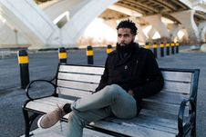 Free Man In Black Jacket Sitting On Outdoor Bench Stock Photography - 114021392