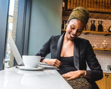 Free Woman In Black Blazer With A Big Smile On Her Face Stock Photography - 114021402