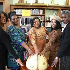 Free Five Women With Hands On Top Of A Wooden Globe Stock Photo - 114021420
