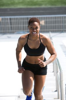 Free Woman Wearing Black Sports Bra And Jogger Shorts Smiling Royalty Free Stock Images - 114021459