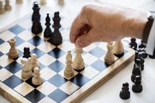 Free Person Holding Queen Chess Piece Stock Images - 114021484