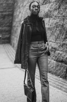 Free Woman In Jacket, Crop Top, And Pants Holding Bag Stock Photo - 114021500