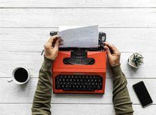 Free Person Operating Red Typewriter Royalty Free Stock Image - 114021566