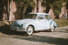 Free Classic Blue Sedan Near Green Leaf Trees At Daytime Stock Photos - 114021573