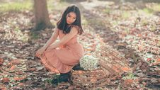 Free Woman Sitting Beside A Flower Bouquet Royalty Free Stock Images - 114021659