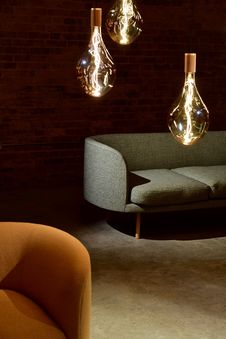 Free Three Edison Light Bulbs Beside The Sofa Stock Photos - 114108573
