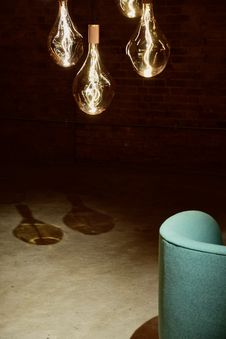 Free Four Hanging Light Bulbs Beside Chair Stock Photos - 114108583
