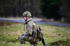 Free Soldier In Green And Brown Camouflage Uniform On Grass Field Stock Image - 114264491