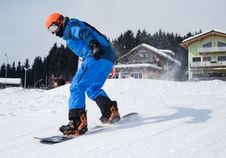 Free Person In Blue Coveralls Snowboarding On Snow Stock Photography - 114264502